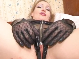 russian mama dressed into latex acquires a penis