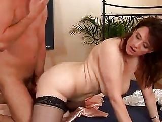 busty older  chick into pantyhose pierced