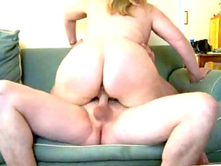 older  plump housewife on furniture