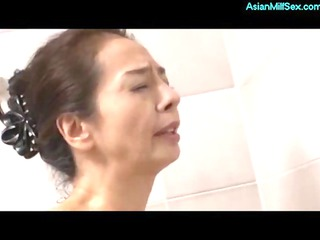 thin cougar woman masturbating into the showr