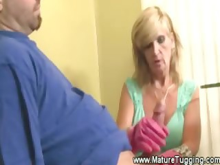 busty mature mature babe tugs dick with gloves on