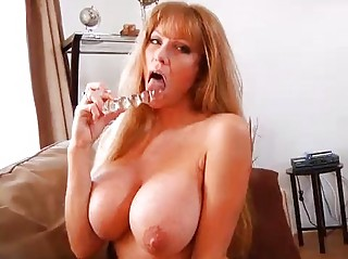 older  bigtit redhaired woman