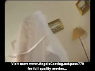 extremely impressive blonde woman as bride does