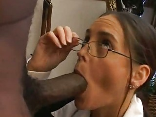 grownup professor eats a huge brown snack