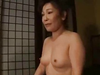 woman inside kimono obtaining her bossom rubbed