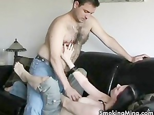 brunette girl licking dick while smoking