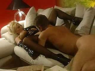 blond woman inside latex obtaining gangbanged