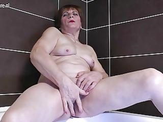 fresh grandma dildoing into the bathroom