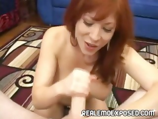 naughty redheaded woman strips, gives a point of